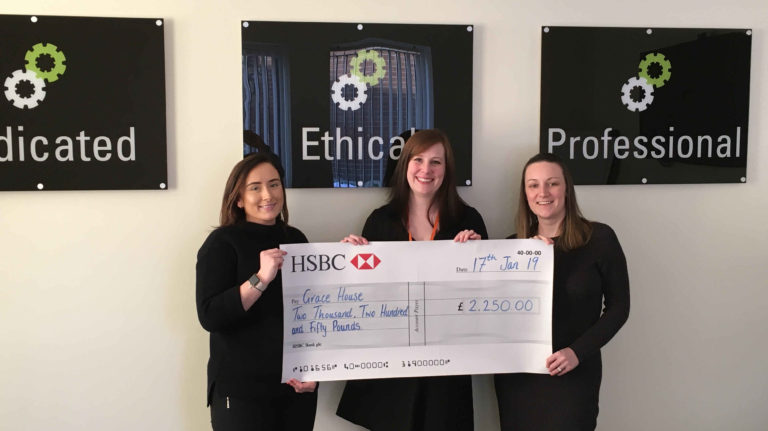 Pictured: Kayla & Louise from NC Insurance present Laura Forbes from Grace House a cheque for £2,250.
